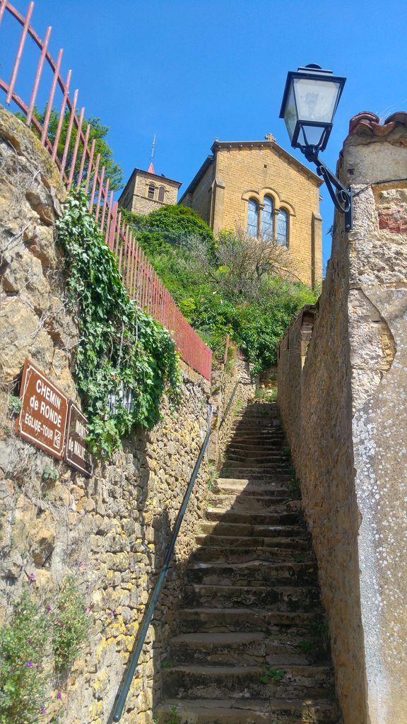 happycurio oingt village medieval